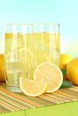 Delicious lemonade on table on light blue background — ストック写真