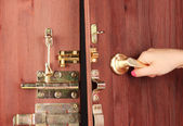 Hand opens door close-up — Stock Photo