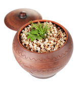 Buckwheat with verdure in pot isolated on white — Stock Photo