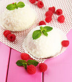 Delicious coconut cakes on table close-up — Stock Photo