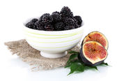 Blackberries in small bowl on sackcloth isolated on white — Stock Photo