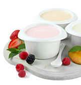 Delicious yogurt with fruit and berries isolated on white — Stock Photo