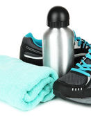 Sports bottle,sneakers and towel isolated on white — Стоковое фото