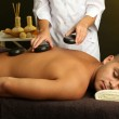 Young man having stone massage in spa salon — Stock Photo #31901913
