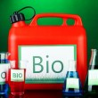 Stock Photo: Bio fuels in canister and vials on green background