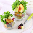 Fruit salad in glasses, on wooden background — Foto de Stock
