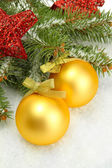 Christmas balls on fir tree with snow, isolated on white — Stock Photo