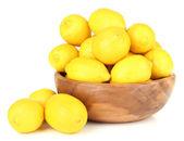 Ripe lemons in bowl isolated on white — Stock Photo