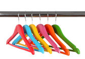 Colorful clothes hangers isolated on white — Stock Photo