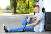 Man on the road with car breakdown waiting for rescue — Stock Photo