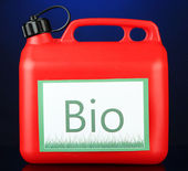 Bio fuels in canister on blue background — Stock Photo