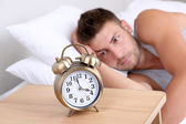 Handsome young man in bed — Foto Stock