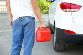 Man handling fuel tank — Stock Photo