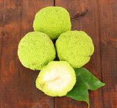 Osage Orange fruits (Maclura pomifera), on wooden background — Stock Photo