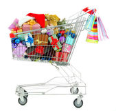 Christmas gifts in shopping trolley, isolated on white — Stockfoto