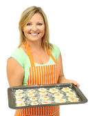 Woman holding tray with raw cookies isolated on white — Stock Photo