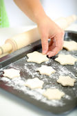 Woman in kitchen during cooking biscuits, close up — Stock Photo