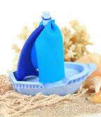 Blue toy ship on sand isolated on white — Stock Photo