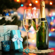 Stock Photo: Glasses of champagne and gifts on bright background