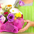 Florist makes flowers bouquet — Stock Photo #32141631