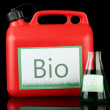 Stock Photo: Bio fuels in canister and vial on black background