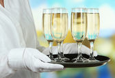 Waitresses holding tray with glasses of champagne — Stock Photo