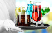 Waitresses holding tray with glasses of cocktails — Stock Photo