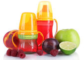 Fruits and baby bottles with compote isolated on white — Stock Photo