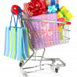Christmas gifts and shopping in trolley isolated on white — Stock Photo #32212839