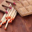 Stock Photo: Long matches and dry fuel, on wooden background