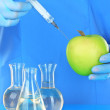 Scientists make injection into fresh apple in laboratory — Stock Photo