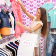 Stock Photo: Beautiful young woman in shop