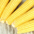 Stock Photo: Crude corns on wooden table