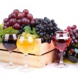 Bottles and glasses of wine and assortment of grapes in wooden crate, isolated on white — Stock Photo