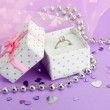 Stock Photo: Beautiful box with wedding ring on purple background