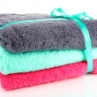 Stock Photo: Towels tied with ribbon isolated on white