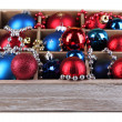 Christmas toys in wooden box isolated on white — Stock Photo #32214747