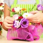 Florist makes flowers bouquet — Stock Photo #32215751