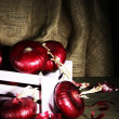 Stock Photo: Fresh red onions in cellar
