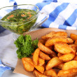 Home potatoes on tracing paper on wooden board near napkin isolated on white — Stock Photo