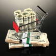 Shopping trolley with dollars, on dark background — Stock Photo #32216311