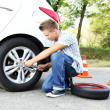 Man driver having trouble at road changing wheel — Stock Photo