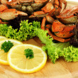 Boiled crabs on wooden board, close-up — Stock Photo #32218313