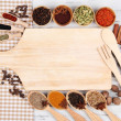 Various spices and herbs with empty wooden board — Stock Photo #32219443