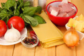 Lasagna ingredients on wooden background — Stock Photo