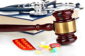 Medicine law concept. Gavel and pills close up — Foto Stock