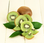 Ripe kiwi on wooden table close-up — Stock Photo