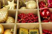 Wooden box filled with christmas decorations background — Foto de Stock