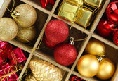 Wooden box filled with christmas decorations background — Stock Photo