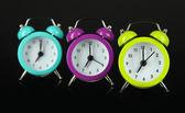 Colorful alarm clock on dark grey background — Stock Photo